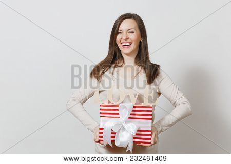 Beautiful Young Sexy Smiling Woman Holding Red Present Box With Gift, Wooden Word Love On White Back