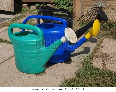 Multicolored plastic watering cans for agriculture