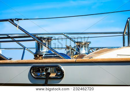 Motor Sailing Yacht Boat Cabing And Steering Wheel On Clear Blue Sky In Background.
