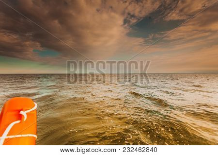 Water Traveling, Adventure Concept. Sea View From Yacht, Lifebuoy Close Up, Calm Water, Sunny Weathe