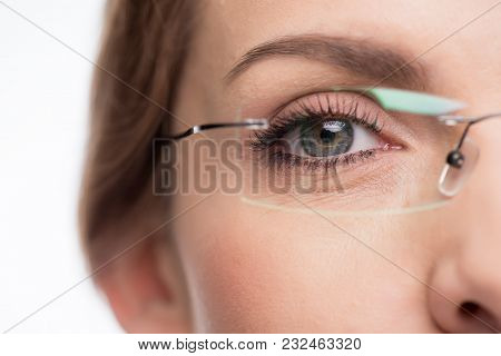 Close-up View Of Young Woman Wearing Glasses Isolated On White