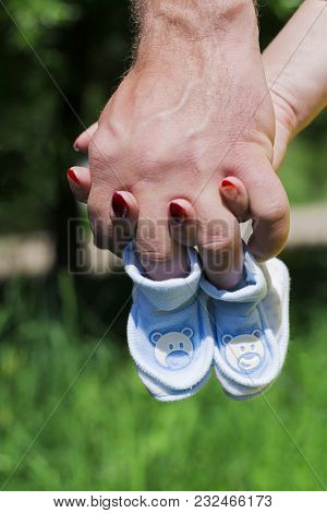 The Couple Is Expecting A Child In The Hands Of Baby Booties, Pregnancy