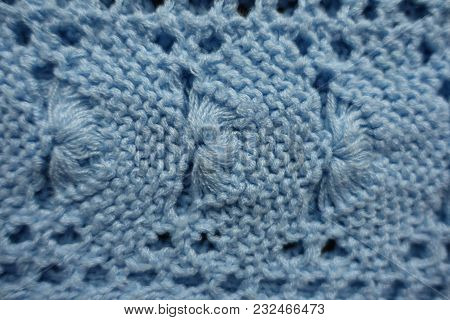 Shell Like Pattern On Sky Blue Knitted Fabric