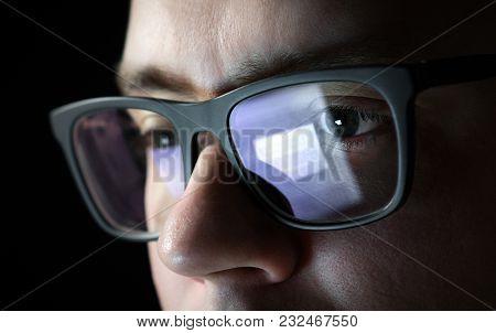 Focused And Thoughtful Man. Coder, Programmer Or Developer Using Laptop In Dark. Businessman Working