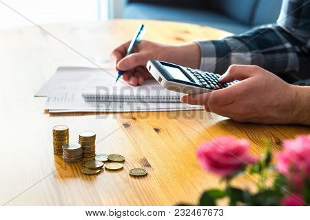 Man Using Calculator And Counting Budget, Expenses And Savings. Low Income Family Living Cost And Ri