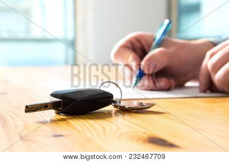 Man Signing Car Insurance Document Or Lease Paper. Writing Signature On Contract Or Agreement. Buyin