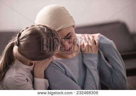Child Hugging And Supporting Sick Mother In Kerchief