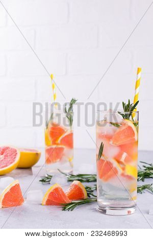 Mineral Infused Water With Grapefruit Ice, And Rosemary On White Background, Homemade Detox Soda Wat