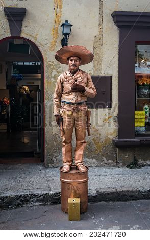 Bogota, Colombia - March 18, 2018: A Man Earns His Life By Making An Act Of A Mexican Human Statue I