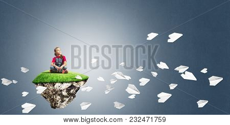 Cute Smiling Girl Sitting On Floating And Looking To The Future