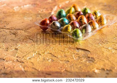 Eggs Of Different Colors, Polka Dot Eggs, Chicken And Quail Eggs Scattered On Board Background