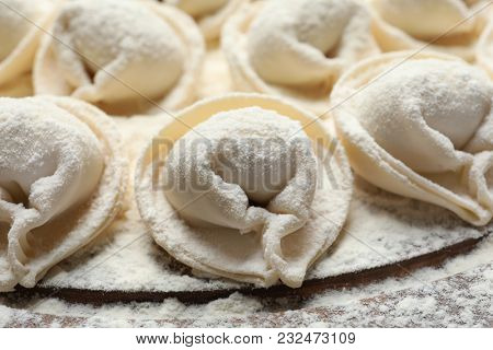 Raw dumplings on board, closeup