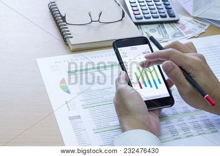 Businessman Analysing Saving Deposit Bank Account In Cash Flow Statement Management With Mobile Appl