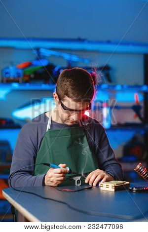 Young Male Engineer Or Technician Repair Soldering Drone Details