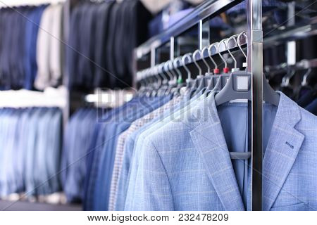 Rack with suit jackets in boutique