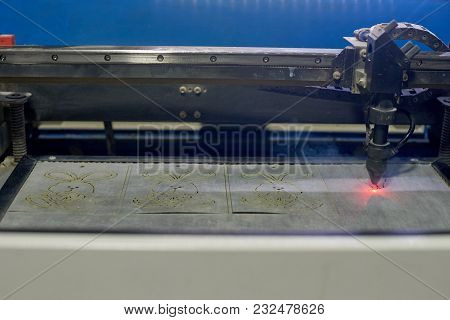 Dnepr, Ukraine- Jan 22, 2018: Laser Cutting Machine Engraving Picture On Plastic Film
