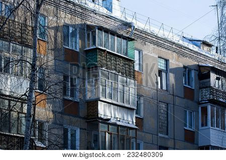 Detail Of Old Five-story Building On The Outskirts In A Residential Area. Cheap Accommodation Built