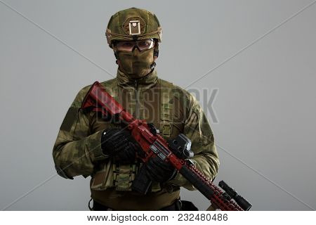 Image of military man with gun