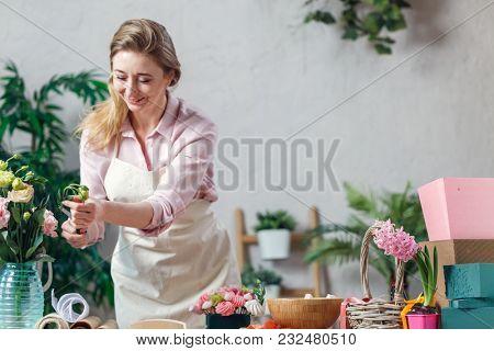 Professional florist working in flower shop.