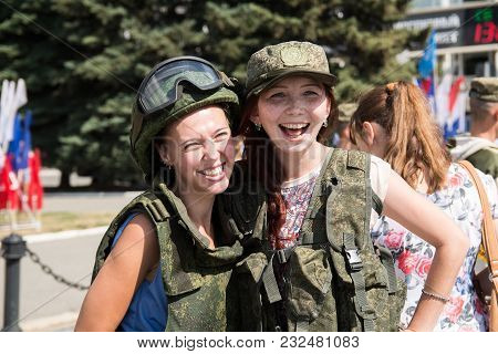 Yoshkar-ola, Russia - August 6, 2016 Young Happy Girls In Military Ammunition During Propaganda Serv