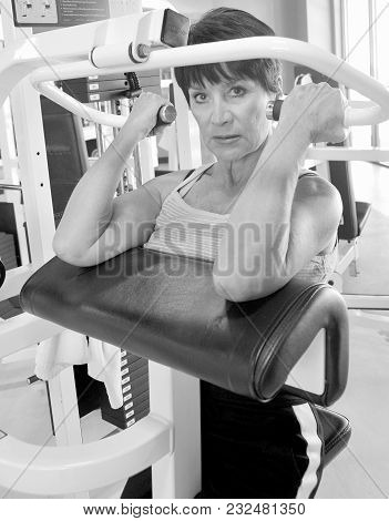 Mature Female Beauty Working Out Inside A Health Club.