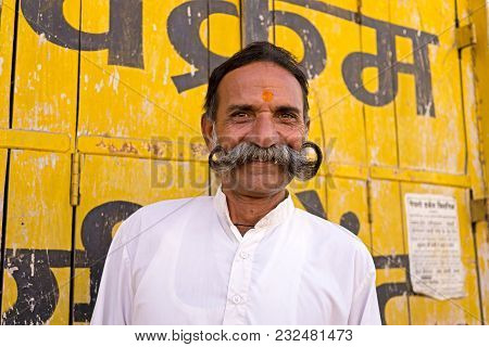 Mandawa, India - February 24, 2018: Portrait Of A Senior Indian Man With Fancy And Cheeky Mustache I