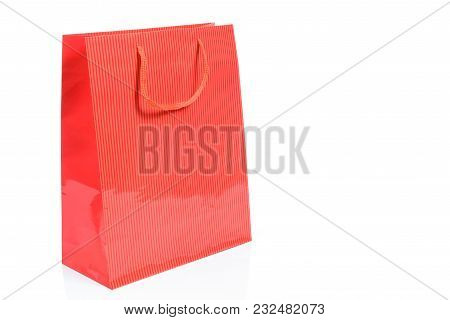 Luxury Red Shopping Bag In Close-up And Isolated On A White Background With Copy Space Place (sample