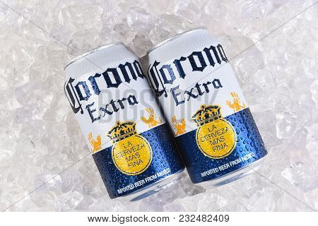 Irvine, California - March 21, 2018: Two 12 Ounce Cans Of Corona Extra Cerveza On Ice. Corona Extra