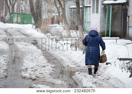 Yoshkar-ola, Russia - April 22, 2017 Deep Puddle With Lumps Snow Melts On The Road In The City, Duri