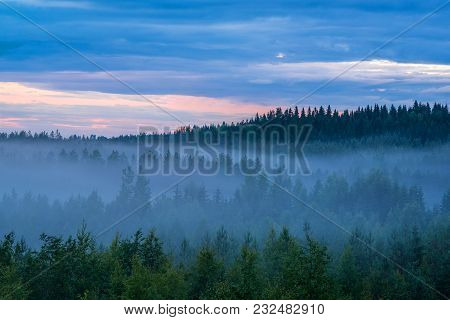Misty Summer Night Landscape With Colorful Cloudy Sky