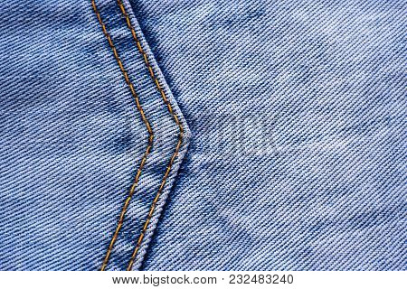 A Large Seam In The Form Of An Arrow On A Denim Blue Fabric