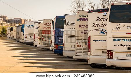 April 1, 2015: Arlington Cemetary Parking Lot, Washington Dc Us-tour Buses Parked In Arlington Natio