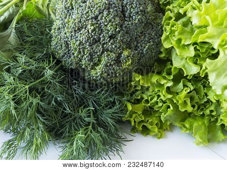 Green Vegetables On A White Background. Spinach, Broccoli, Dill And Lettuce. Green Vegetables At Bor