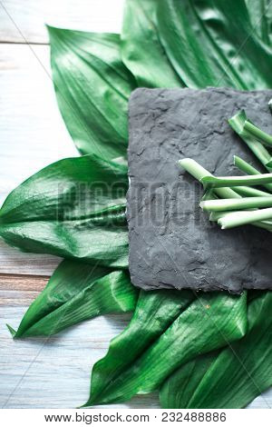 Sliced Green Stems On A Black Kitchen Board.
