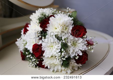 Bridal Bouquet Of Various Flowers Lies On A Table. Wedding Accessories.