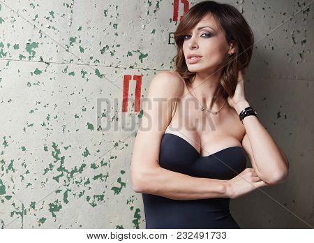 Sexy Brunette Woman In A Black Underwear.