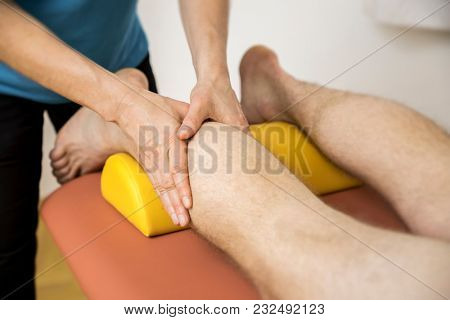 An image of a physiotherapy calf massage