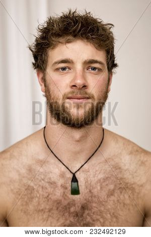 An image of a sad looking young bearded man