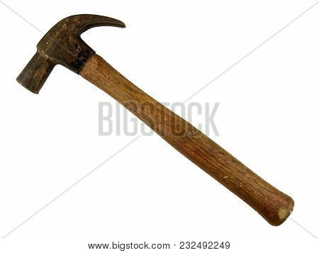 A Well Used Wooden Handled Hammer With A Rusty Head