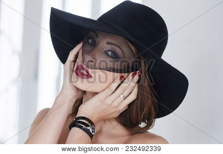 Portrait Of A Woman In A Black Evening Hat.