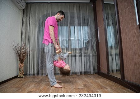 Father And His Son Do Acrobatic Exercises