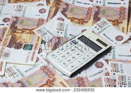 Lots Of Money And A Close-up Calculator