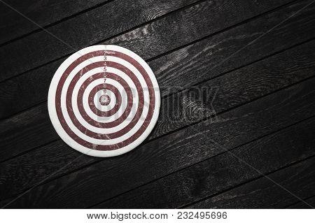Business Achievements Concept. Dart On Wooden Background