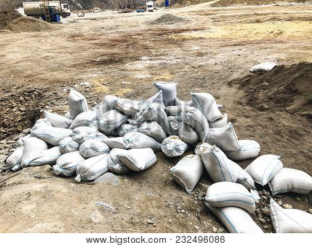 Tbilisi, Georgia - March 17, 2018: White Sandbags Are Lying On The Ground At The Construction Site I