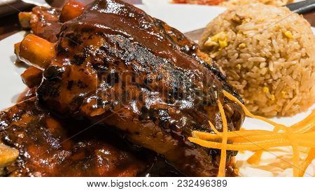 Close Up Shot Of Delicious Ribs Barbeque With Fried Rice A Mouth Watery Bbq Ribs Perfect For Your Im