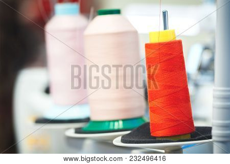 Bobbins With Red And Rose Thread For Industrial Textile Machines
