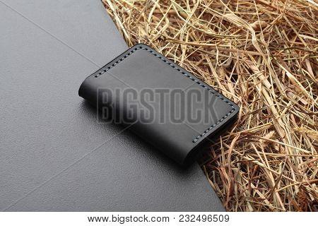 Black Card Holder. Hand Made Leather Man Card Holder. Multi Colored. Leather Craft.on Creative Backg