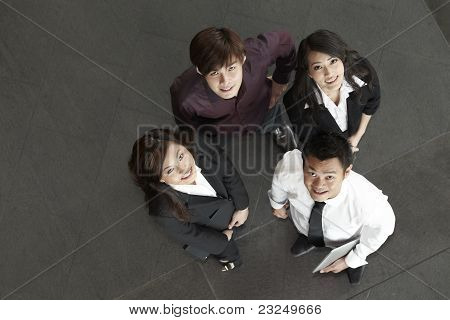 Asian Business People Standing Together Looking Up