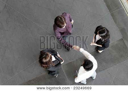 High Angle View Of Asian Business People Shaking Hands.