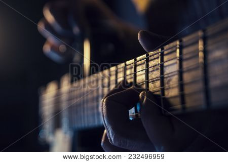 Rock Concert, A Musician Is Playing The Guitar
